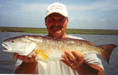 Mitch Mcbride with a nice Redfish - May