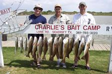 Wes Seidel with Dad and Darrel Hunter - Limits of July Redfish
