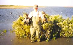 Justin Gray with mixed bag of ducks.